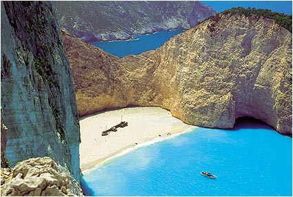 SHIPWRECK - Another worthwhile sight on Zakynthos, which has made the rounds of the island through postcards that represent it on every occasion, is the Navayio (Shipwreck or Smuggler's Cove) on its west side. Definitely one of the most famous and the most photograp by Manolis Tsantakis
